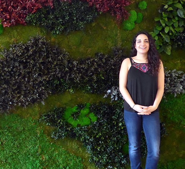 Danielle Pal in front of the Green Wall in the Buttery