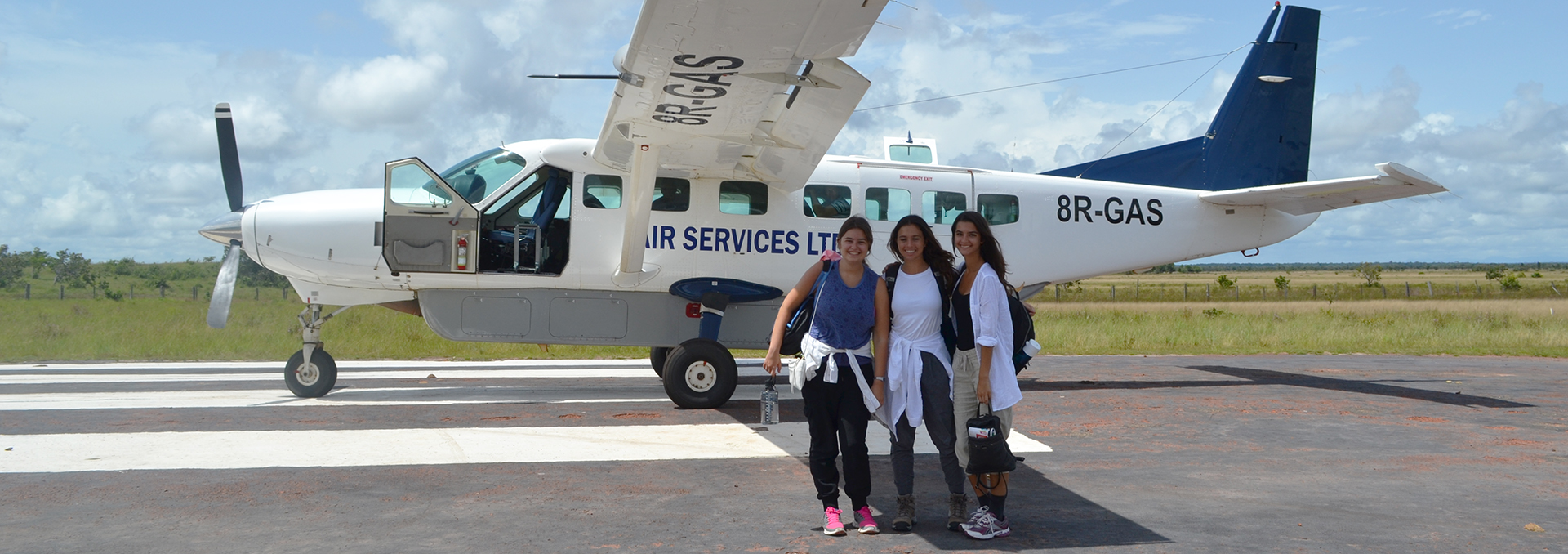 QEII students board a plane in Guyana as part of their internships 2016