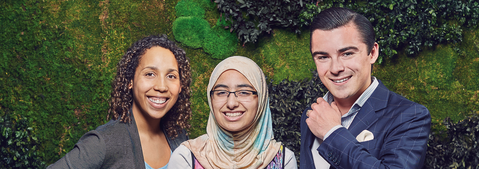 Ramata Tarawally with students in front of the Green Wall in the Buttery