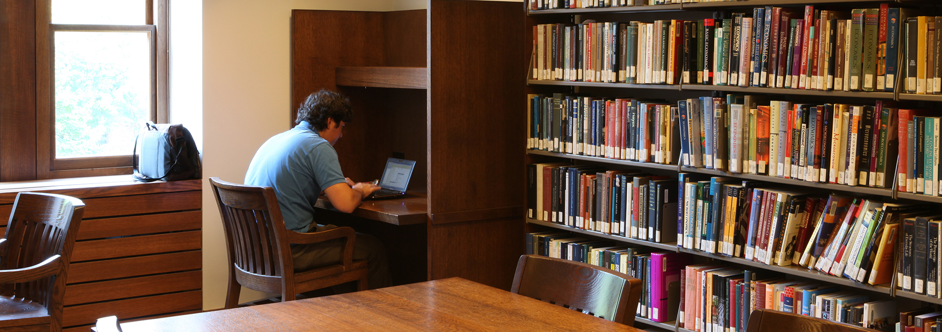 Student studying at a carrel in the John W Graham Library