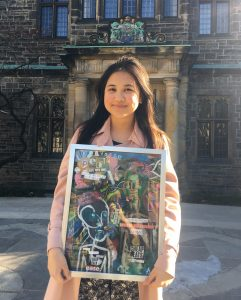 Angel Bella, Trinity One student hold her artwork for TCURC