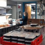 Maggie Helwig in the church kitchen preparing food
