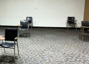 Desks in a classroom set up with physical distancing