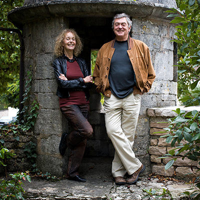 Martha and George Butterfields stand infront of a stone structure