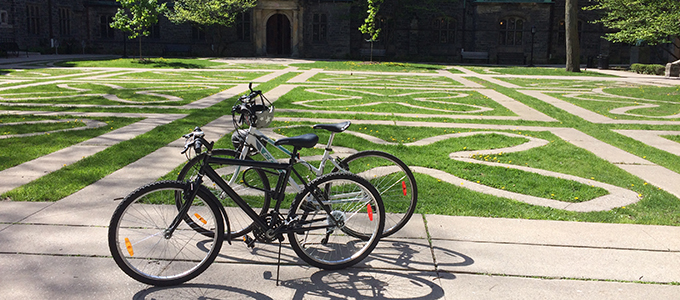 Two bicycles from Trinity's Bicycle Recycling Program in the Trinity Quad