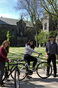 Students sitting on bicycles from Trinity's Bicycle Recycling Program