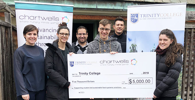 Trinity students and Assistant Provost Dr. Jonathan Steels receive Chartwells Campus Project prize