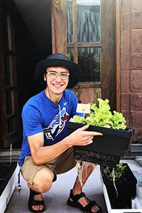 Nathan Postma with a garden planter