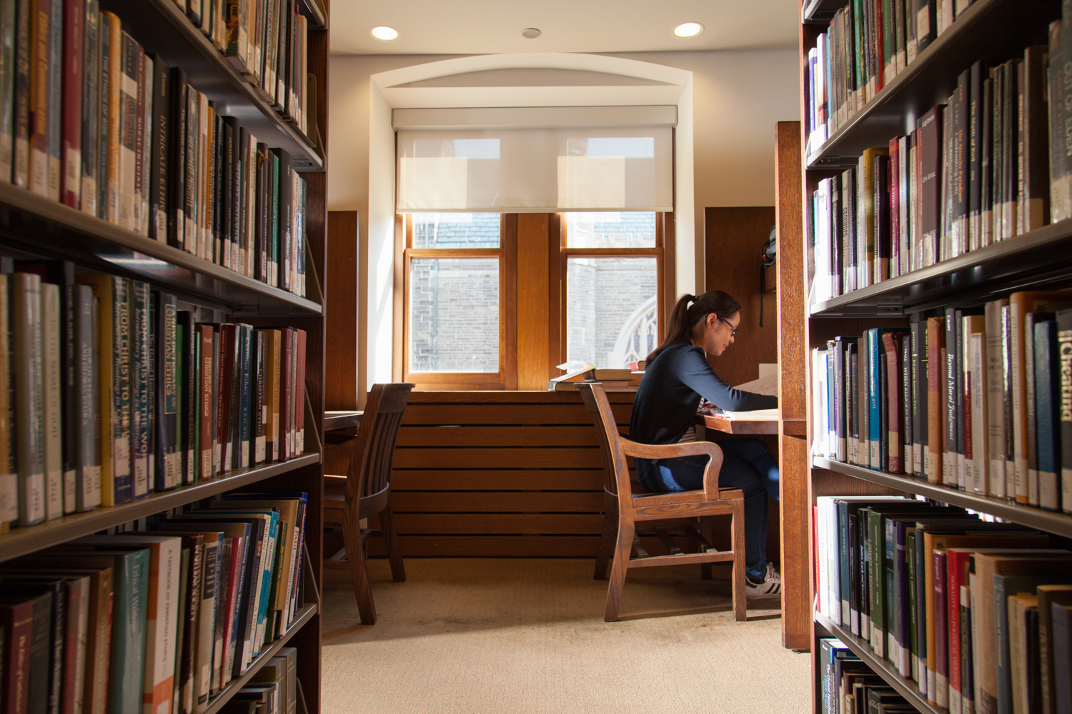 Student studying in a carrel in the John W. Graham Library